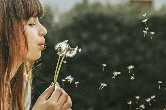 Girl Blowing on Dandelion-resized